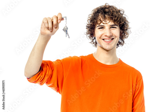 young man holding keys portrait