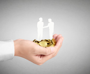 Businessman holding of coins