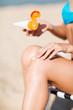 girl putting sun protection cream on beach chair