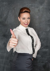 Fashion woman showing thumbs up sign