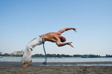 Acrobatic stunt on the beach