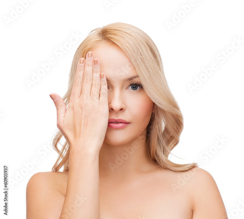 beautiful woman covering half of face with hand
