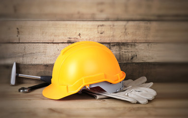 Yellow hardhat and leather gloves