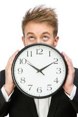 Portrait of businessman holding clock