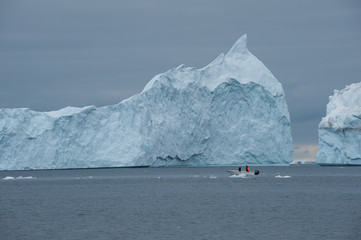 Fisherman's boat and icebergs in Greenland
