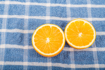 Halved Oranges on Blue Towel