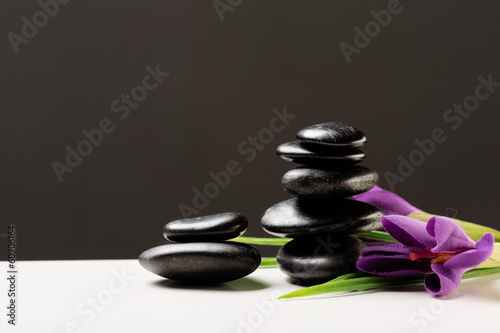 massage stones with flowers on mat