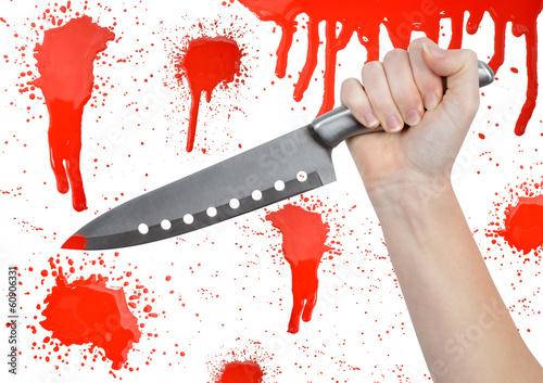 Hand with knife on the background bloody splatters