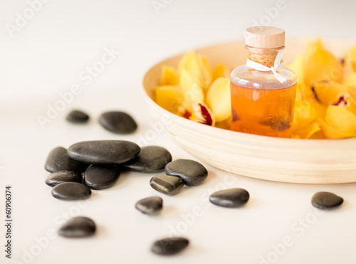 massage stones with flowers on table