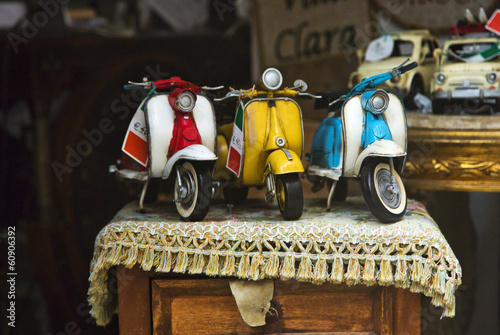 Close-up of toy scooters for sale
