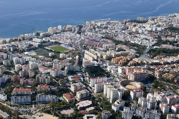 Aerial view of Marbella with its soccer field and bull ring.