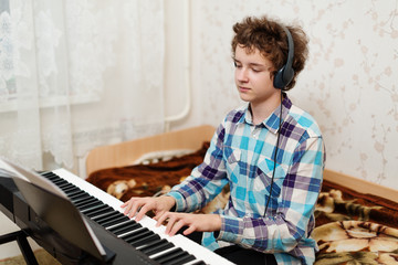 boy plays piano