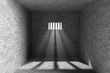 Prison interior with light shining through a barred window