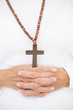 Praying hands and christian crucifix .