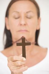 Religious Woman holding christian symbol