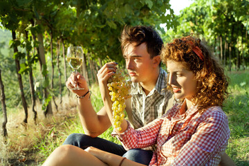 farming couple relaxing after the grape harvest