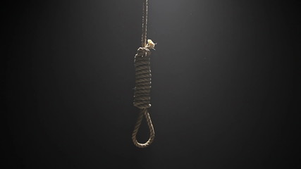 Falling Hangman Noose over black background