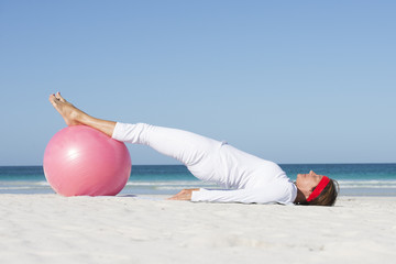 Mature woman sporty lifestyle beach
