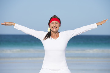 Fit happy healthy mature woman exercising