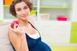 Pregnant woman holding garnet