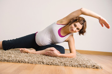 Young pregnant woman doing yoga execises