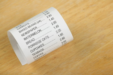 Shopping Receipt for Groceries on a Wood Background
