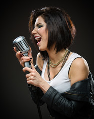 Half-length portrait of female rock singer