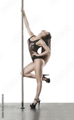Young fit  women standing near the pole