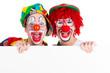 clowns mit hinweisschild