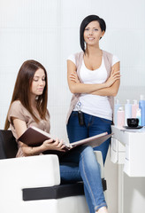 Hairdresser and the client in hairdressing salon