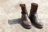 A pair of old brown boots