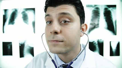 Attractive Male Doctor Examining Showing ok sign