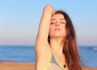 Beautiful woman enjoing on the beach blue background