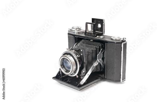 Leinwanddruck Bild vintage bellows film camera circa 1940 isolated on white