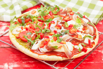Pizza. Delicious oven ready pizza with bacon  and vegetables
