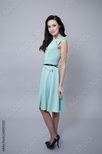 Beautiful young woman in a turquoise dress