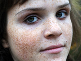 portrait of freckled teenage girl