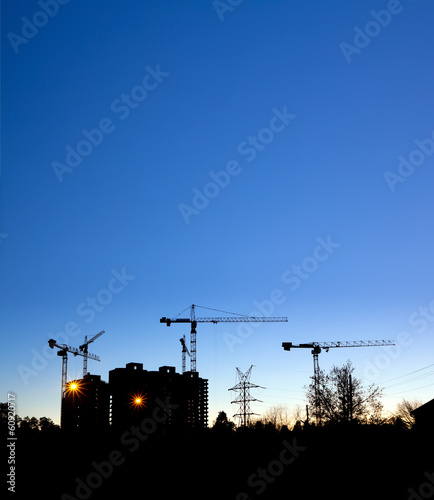 Construction site with cranes, building
