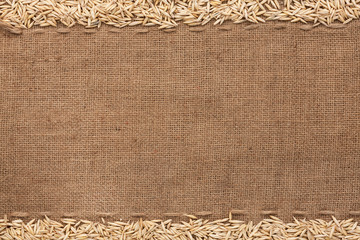 Oat lying on sackcloth