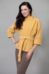 Beautiful young woman in autumn coat