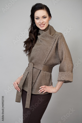 Beautiful young woman in autumn coat