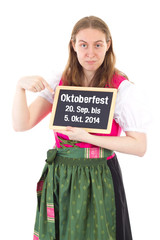 Girl in dirndl shows period of Oktoberfest 2014 on chalkboard