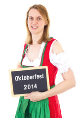 Woman in dirndl shows blackboard : Oktoberfest 2014