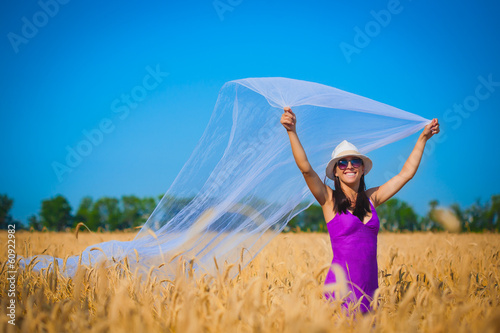 happy girl in a wheat field