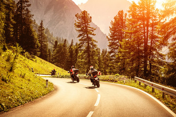 Group of motorcyclists on mountainous road