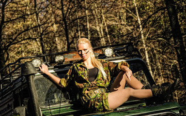 Girl and off-road vehicle