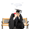 Worried student holding diploma and cloud floating over his head