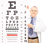 Male optician pointing to an eyesight test with a stick