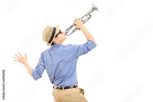 Excited young musician playing trumpet