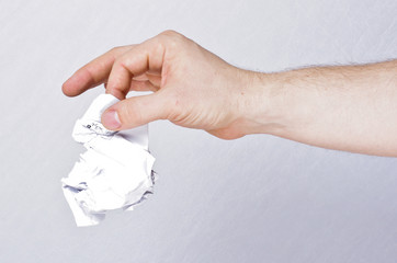 Male hand holding crumpled paper